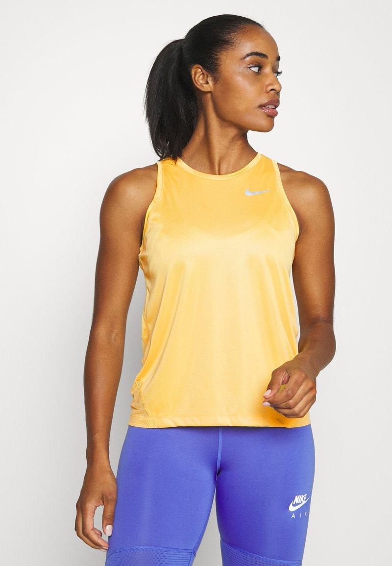 Nike Performance - MILER TANK - Sports shirt - topaz gold/silver