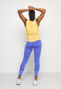 Nike Performance - MILER TANK - Sports shirt - topaz gold/silver - 2