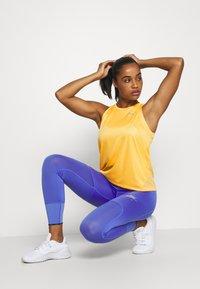 Nike Performance - MILER TANK - Sports shirt - topaz gold/silver - 1