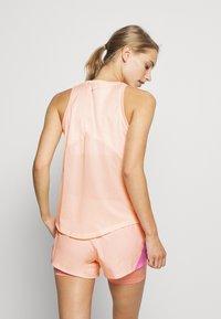 Nike Performance - MILER TANK - Camiseta de deporte - washed coral/reflective silver - 2