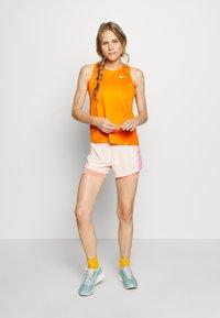 Nike Performance - MILER TANK - Camiseta de deporte - magma orange/reflective silver - 1