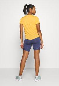 Nike Performance - MILER  - Print T-shirt - topaz gold/reflective silver - 2
