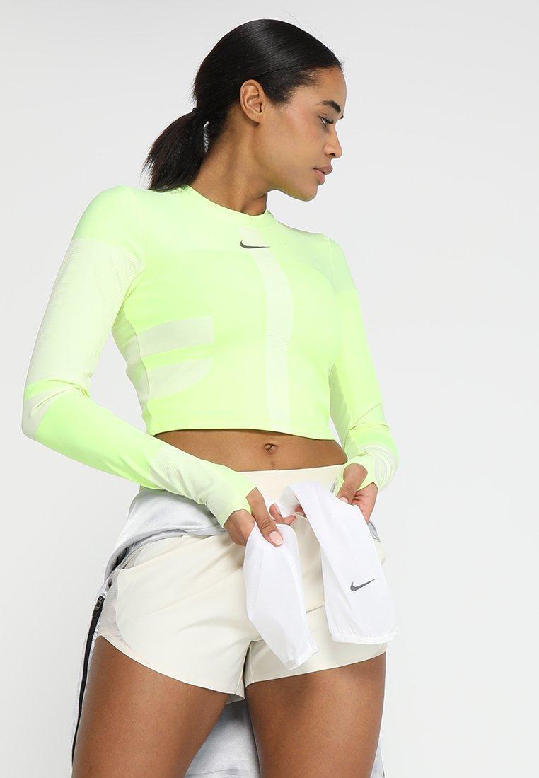 Nike Performance - TECH PACK RUNNING LONG SLEEVE TOP - Maglietta a manica lunga - volt/light cream/silver