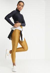 Nike Performance - TECH PACK LONG SLEEVE TOP - Top sdlouhým rukávem - oil grey/black - 1