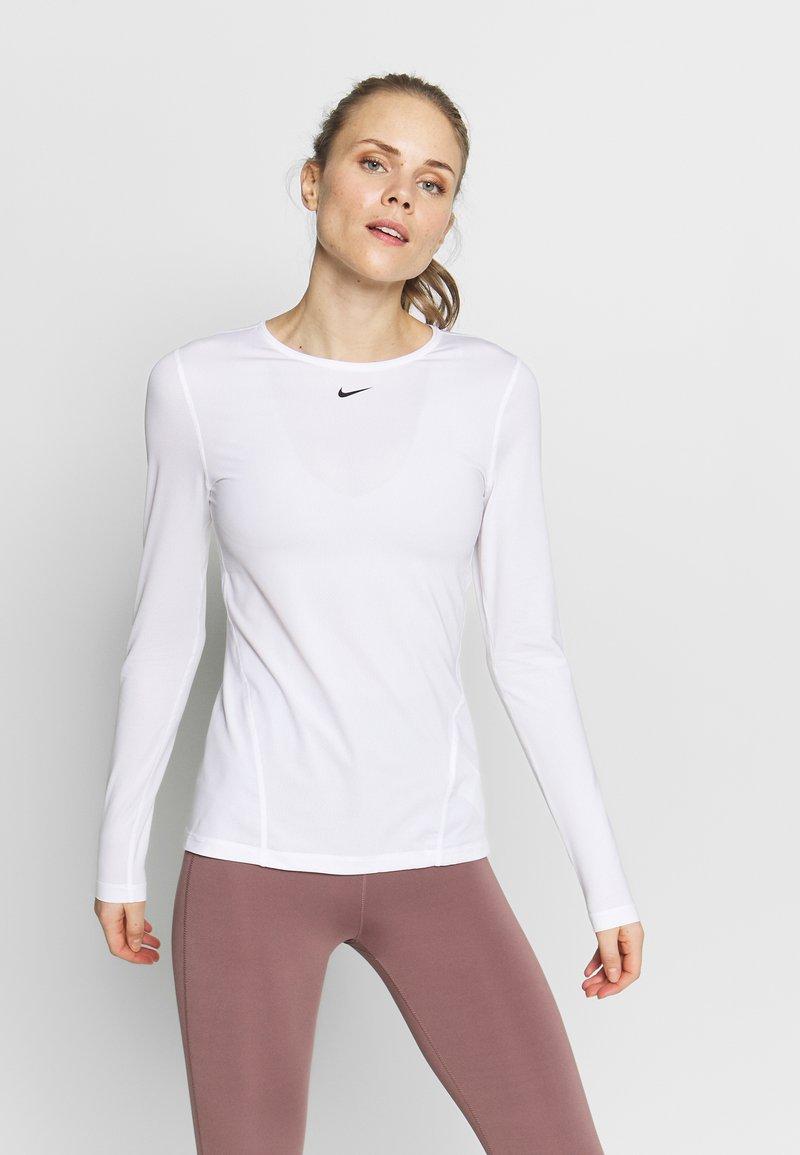 Nike Performance - ALL OVER - Sports shirt - white/black