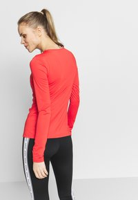 Nike Performance - ALL OVER - Sports shirt - track red/white - 2