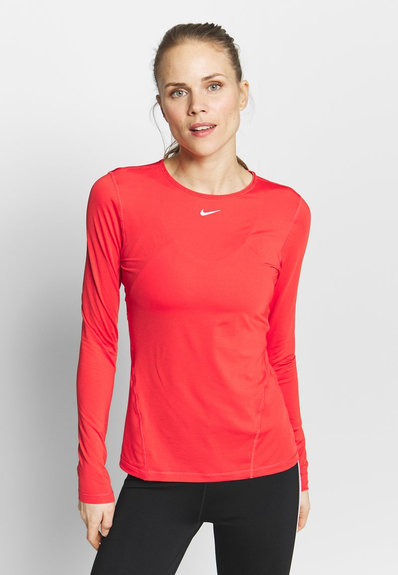 Nike Performance - ALL OVER - Sports shirt - track red/white