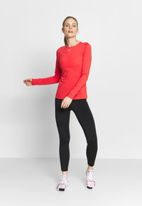 Nike Performance - ALL OVER - Sports shirt - track red/white - 1