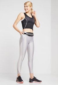 Nike Performance - MILER TANK CROP - Sports shirt - black/white/reflective silver - 1