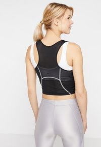 Nike Performance - MILER TANK CROP - Sports shirt - black/white/reflective silver - 2