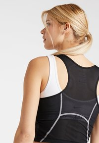 Nike Performance - MILER TANK CROP - Funktionsshirt - black/white/reflective silver - 4