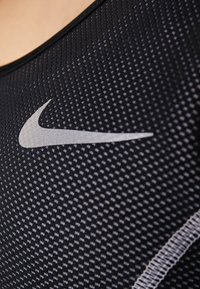 Nike Performance - MILER TANK CROP - Sports shirt - black/white/reflective silver - 7