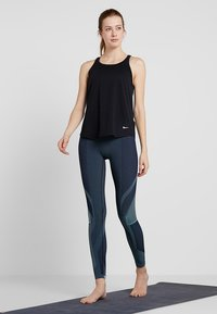 Nike Performance - TANK LOOSE - Camiseta de deporte - black - 1