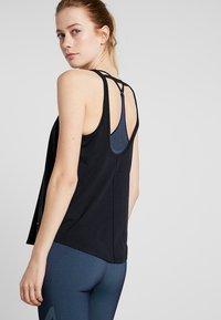 Nike Performance - TANK LOOSE - Camiseta de deporte - black - 2