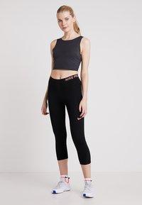 Nike Performance - TANK - Topper - oil grey/black - 1