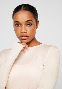 Nike Performance - MILER TOP - Sports shirt - echo pink/reflective silver - 6
