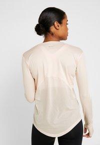 Nike Performance - MILER TOP - Sports shirt - echo pink/reflective silver - 2