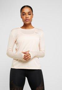 Nike Performance - MILER TOP - Sports shirt - echo pink/reflective silver - 0
