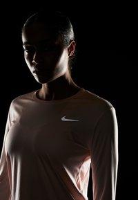 Nike Performance - MILER TOP - Sports shirt - echo pink/reflective silver - 4
