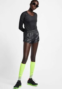 Nike Performance - T-shirt de sport - black - 1