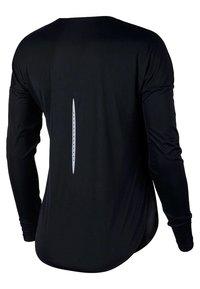 Nike Performance - T-shirt de sport - black - 5