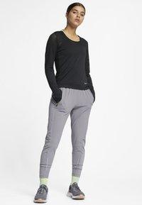 Nike Performance - Funktionsshirt - black - 1