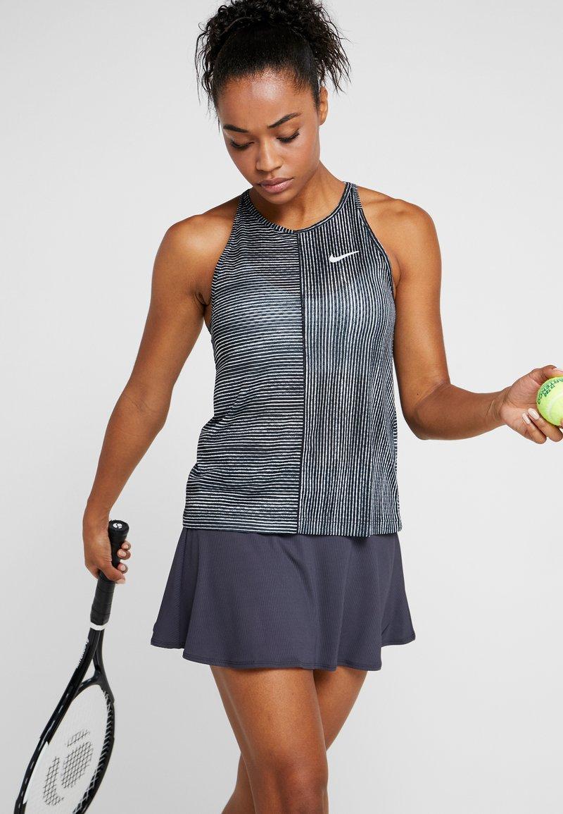 Nike Performance - W NKCT - Sports shirt - black/white