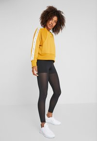 Nike Performance - DRY GET FIT  - Sweater - gold suede/black - 1