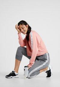 Nike Performance - DRY GET FIT  - Mikina - pink quartz/black - 1