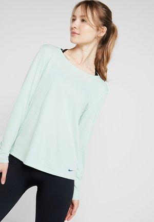 DRY ELASTIKA - Sports shirt - pistachio frost/mystic navy