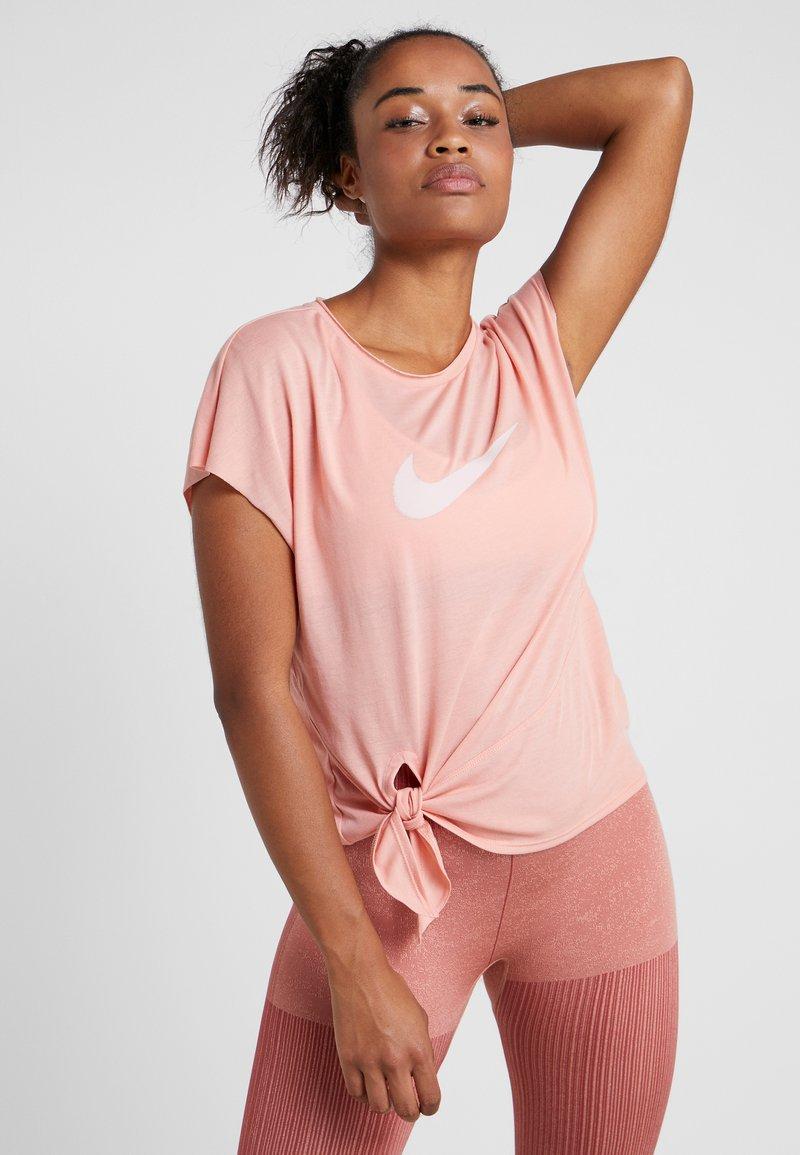 Nike Performance - DRY SIDE TIE - Print T-shirt - pink/echo pink