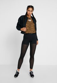 Nike Performance - DRY TANK LEOPARD CROP - Sports shirt - club gold/british tan/black/white - 1