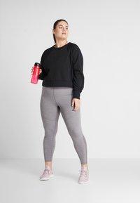 Nike Performance - ALL IN PLUS - Sweatshirt - black/white - 1