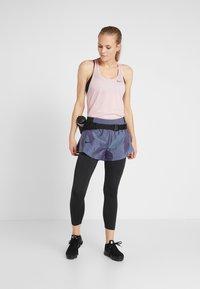 Nike Performance - MILER TANK RACER - Sports shirt - echo pink/reflective silver - 1