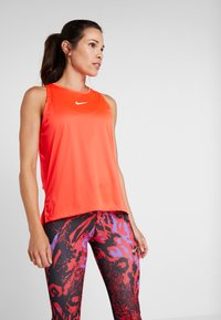 Nike Performance - TANK REBEL - Sportshirt - bright crimson/white - 0