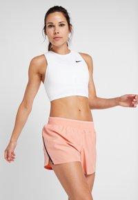 Nike Performance - TANK REBEL - Treningsskjorter - white/black - 0