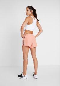 Nike Performance - TANK REBEL - Treningsskjorter - white/black - 2