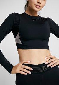 Nike Performance - CAPSULE AERO-ADAPT - Sports shirt - black/metallic silver - 7