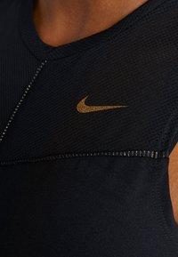 Nike Performance - FIERCE TANK - Sports shirt - black/metallic gold - 5