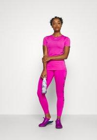 Nike Performance - ALL OVER - Camiseta estampada - active fuchsia/white - 1