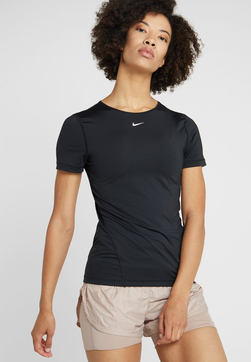 Nike Performance - ALL OVER - T-shirt con stampa - black/white