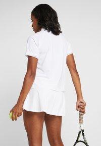 Nike Performance - ESSENTIAL  - Sports shirt - white/black - 2