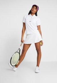 Nike Performance - ESSENTIAL  - Sports shirt - white/black - 1