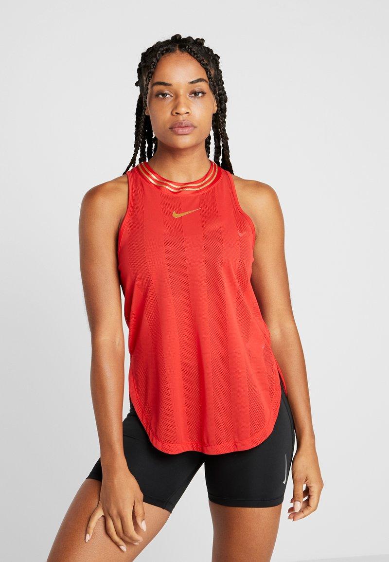 Nike Performance - TANK GLAM - Funkční triko - university red/metallic gold