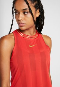 Nike Performance - TANK GLAM - Funkční triko - university red/metallic gold - 5