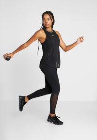Nike Performance - TANK GLAM - Sportshirt - black/metallic gold - 1
