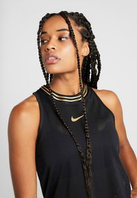 Nike Performance - TANK GLAM - Sportshirt - black/metallic gold - 3
