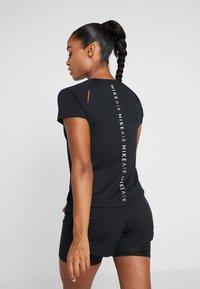 Nike Performance - AIR - Print T-shirt - black/white - 2