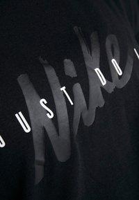 Nike Performance - DRY - T-shirt z nadrukiem - black/white - 6