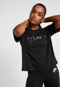 Nike Performance - DRY - T-shirt z nadrukiem - black/white - 0